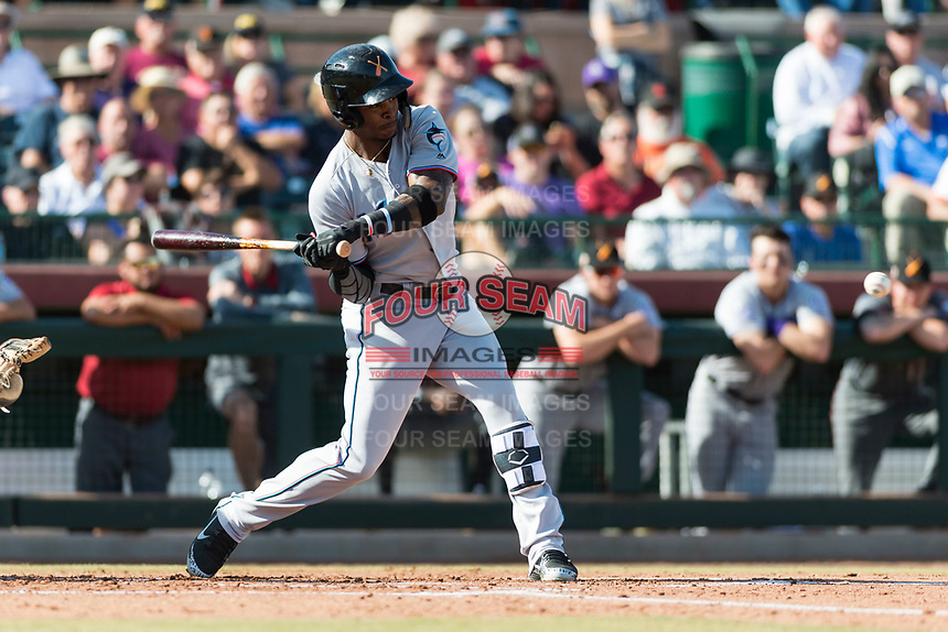 Salt River Rafters center fielder Monte Harrison (4), of the Miami Marlins organization, swings at a pitch during the Arizona Fall League Championship Game against the Peoria Javelinas at Scottsdale Stadium on November 17, 2018 in Scottsdale, Arizona. (Zachary Lucy/Four Seam Images)