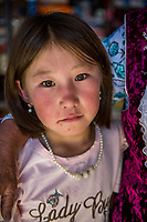 Mongolia, Bayan-Ulgii, Ulgii, Altai Mountains. Woman and girl in local market.