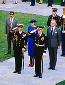 Princess Diana, center in blue dress, looks on as her husband Prince Charles, left center, salutes during a ceremony to lay a wreath at the Tomb of the Unknowns in observance of Veterans Day at Arlington National Cemetery in Arlington, Virginia on November 11, 1985.<br /> Credit: Arnie Sachs / CNP