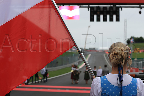 03.07.2016. Red Bull Circuit, Spielberg, Austria. F1 Grand pix of Austria. Race Day.  A grid girl at the race start
