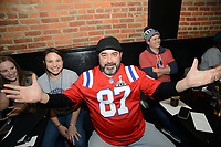 Patriots fans, led by Roger Fournier of Lowell, Massachusetts showing off his jersey at Smith's Bar & Restaurant Sunday, February 04, 2018 in Philadelphia, Pennsylvania. Generally a Patriots hangout, the bar was overridden by Eagles fans singing the Eagles fight song.  WILLIAM THOMAS CAIN / For The Inquirer