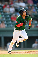 Third baseman Tanner Nishioka (30) of the Greenville Drive runs out a batted ball in a game against the Asheville Tourists on Sunday, June 3, 2018, at Fluor Field at the West End in Greenville, South Carolina. Greenville won, 7-6. (Tom Priddy/Four Seam Images)