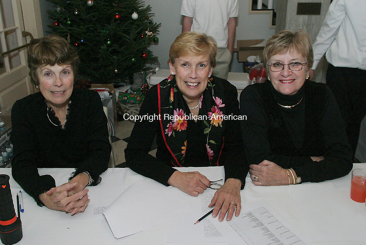 WASHINGTON, CT - 31 December 2004 -123104BZ08-  From left- Phyllis Allen, of Washington; Kathy Gollow, of Washington; Joanette Johnson, of Washington, members of the 225th New Years Eve Gala Committee<br /> <br /> during the town's 225th anniversary New Year's Eve Gala at the Bryan Memorial Town Hall Friday night.<br /> Jamison C. Bazinet Photo.