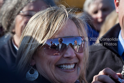 United States President Barack Obama is seen reflected in sunglasses as he greets people on the tarmac following his arrival at Portland International Jetport in Portland, Maine, March 30, 2012. .Mandatory Credit: Pete Souza - White House via CNP