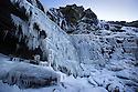 20/01/16<br /> <br /> Only 160 miles, as the crow flies from central London, Will Flanagan (36), explores the stunning icicles at Kinder Downfall near Hayfield in the Derbyshire Peak district today. After days of cold sub-zero temperatures the 100 ft waterfall finally froze over last night.<br /> <br /> Will said: &quot;I had to set off at dawn to to get up here. I've been watching the overnight temperatures and thought there's be a chance it would be frozen today. <br /> <br /> &quot;As the sun began to rise the ice started to melt. I could here it cracking beneath my feet and I saw a few giant icicles crash down. So I didn't stay up there very long!<br /> <br /> &quot;I definitely wouldn't have wanted to climb any higher up it today even if I'd had ropes with me - the ice wouldn't have been strong enough to support me. If I'd have arrived any later I wouldn't have risked going all the way up. <br /> <br /> &quot;But all the same it was an awesome spectacle and one of the most extreme walks I've ever done.&quot;<br /> <br /> The waterfall flows from Kinder Scout the only mountain in the Derbyshire Peak District between Hayfield and Edale. <br /> <br /> <br /> All Rights Reserved: F Stop Press Ltd. +44(0)1335 418365   www.fstoppress.com.