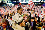 Delegate Jarrett Barios, from Cambridge, Mass. carries his son Nathaniel, 8, on his shoulders during the Democratic National Convention at the FleetCenter in Boston, Wednesday, July 28, 2004. (AP Photo/Victoria Arocho)