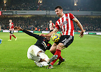 24th November 2019; Bramall Lane, Sheffield, Yorkshire, England; English Premier League Football, Sheffield United versus Manchester United; Aaron Wan-Bissaka of Manchester United  blocks the ctoss from Enda Stevens of Sheffield United - Strictly Editorial Use Only. No use with unauthorized audio, video, data, fixture lists, club/league logos or 'live' services. Online in-match use limited to 120 images, no video emulation. No use in betting, games or single club/league/player publications