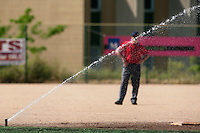 24 May 2009: a sprinkler turns on during the 2009 challenge de France, a tournament with the best French baseball teams - all eight elite league clubs - to determine a spot in the European Cup next year, at Montpellier, France. Senart wins 8-5 over La Guerche.