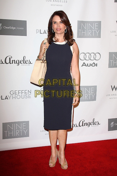 ROMA DOWNEY.7th Annual Backstage At The Geffen Gala held at the Geffen Playhouse, Los Angeles, California, USA..March 9th, 2009.full length black blue dress white stripe beige bag purse open toe shoes .CAP/ADM/KB.©Kevan Brooks/AdMedia/Capital Pictures.