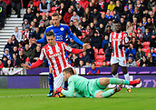 4th November 2017, bet365 Stadium, Stoke-on-Trent, England; EPL Premier League football, Stoke City versus Leicester City; Jack Butland of Stoke City gathers the ball safely shielded by Kevin Wimmer and foiling Jamie Vardy of Leicester City