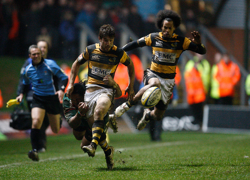 Photo: Richard Lane/Richard Lane Photography. Leicester Tigers v London Wasps. Aviva Premiership. 19/02/2011. Wasps' Dominic Waldouck, with Richard Haughton in support kicks ahead as he is tackled by Tigers' Alesana Tuilagi tackles.