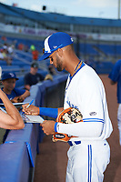 Dunedin Blue Jays shortstop Lourdes Gurriel (13) signs autographs before a game against the St. Lucie Mets on April 19, 2017 at Florida Auto Exchange Stadium in Dunedin, Florida.  Dunedin defeated St. Lucie 9-1.  (Mike Janes/Four Seam Images)