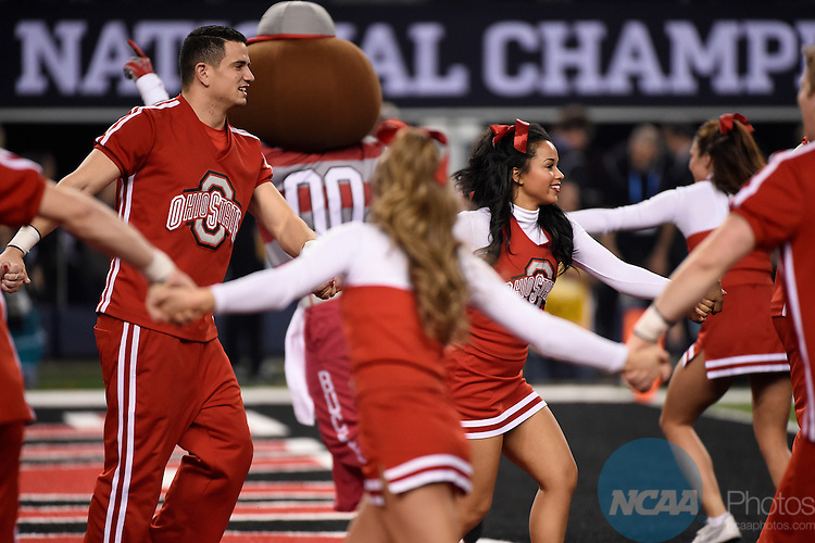 12 JAN 2015:  Cheerleaders celebrate after Nick Vannett (81) of the Ohio State University scores a touchdown against the University of Oregon during the College Football Playoff National Championship held at AT&T Stadium in Arlington, TX.  Ohio State defeated Oregon 42-20 for the national title.  Jamie Schwaberow/NCAA Photos
