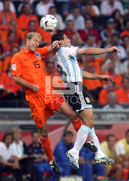 Netherland's Tim De Cler (15) and Argentina's Maxi Rodriguez (18) go up for a header. Argentina and the Netherlands played to a 0-0 draw in their FIFA World Cup Group C match at FIFA World Cup Stadium, Frankfurt, Germany, June 21, 2006.
