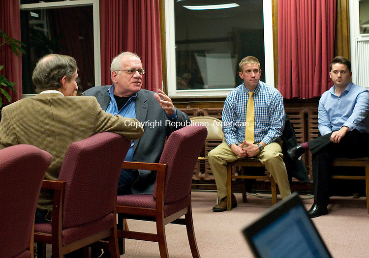 Torrington, CT- 30 November 2015-113015CM10- Jim Parry creative director at The CauseWay Agency, center, speaks to a group of people at the Torrington Board of Education office on Monday.  The group is putting together a marketing campaign and is aiming to help the Torrington High School.   Christopher Massa Republican-American