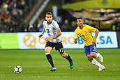June 9th 2017, Melbourne Cricket Ground, Melbourne, Australia; International Football Friendly; Brazil versus Argentina; Nicolas Otamendi of Argentina runs forward with the ball whilst being chased by Gabriel Jesus of Brazil