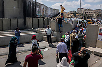 Palestinians cross the Qalandia check point of the separation barrier between Israel and the West Bank at on June 10, 2016 in West Bank. <br /> Photo Daniel Berehulak for the New York Times