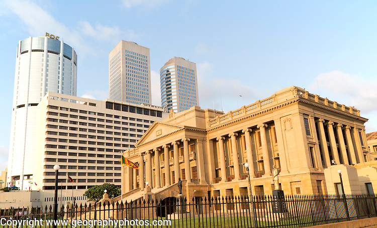 Old Parliament Building now the Presidential Secretariat offices, Colombo, Sri Lanka and modern skyscraper buildings