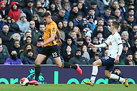 Leander Dendoncker of Wolverhampton Wanderers and Giovani Lo Celso of Tottenham Hotspur during Tottenham Hotspur vs Wolverhampton Wanderers, Premier League Football at Tottenham Hotspur Stadium on 1st March 2020