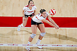 Wisconsin Badgers Allison Wack (11) hits the ball during an NCAA volleyball match against the Michigan Wolverines at the Field House on October 30, 2010 in Madison, Wisconsin. Michigan won the match 3-1. (Photo by David Stluka)