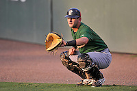 Catcher Tyler Moore (2) of the Savannah Sand Gnats warms up before in a game against the Greenville Drive on Thursday, September 3, 2015, at Fluor Field at the West End in Greenville, South Carolina. (Tom Priddy/Four Seam Images)