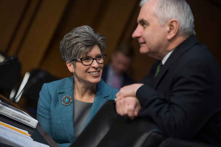 UNITED STATES - FEBRUARY 08: Sens. Joni Ernst, R-Iowa, and Jack Reed, D-R.I., attend a Senate Armed Services Committee hearing on nominations in Hart Building on February 8, 2018. (Photo By Tom Williams/CQ Roll Call)