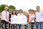 FUNDS: The Parents Association of Nagle-Rice Primary School present the proceeds of recent fundraisers to school principal, Liam Fell accompanied by special guest at the school on Friday, Marc O? Se?, l-r: Darina Burke, Irene O'Sullivan, Breda O'Leary, Christina O'Brien.