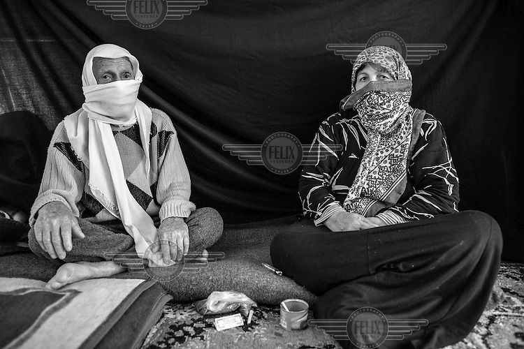Ayman, 82, (left) and his wife Yasmine, 67, (names changed to protect their identities) pose for a portrait in Nizip refugee camp in Turkey. They fled their home in a rural area near Aleppo in August 2012 after their 70-year-old neighbour and his son, a shepherd, were killed. Their home stands on 10,000 square meters of land covered with olive trees, grapes, nuts and fruits. Breaking into tears, Ayman described how nearby farms came under attack and homes were looted and set on fire. 'It is unbelievable that any human being can do this to another,' he says. 'There is no place that compares to home, but on the day we crossed the border, 19 people from our village were killed. Here, at least we feel safe. At least we haven't heard the noise of shelling for two months now. At home we lived like kings and queens. Now, we are refugees. What I miss most is my farm. I miss the olive trees. I don't even know if my house is still standing.' The most important thing Ayman was able to bring with him from Syria is his wife. 'She's the best woman that I've met in my life,' he says. 'Even if I were to go back 55 years, I would choose you again.'
