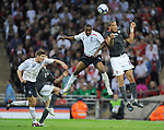 Jermain Defoe of England rises up with Oguchi Onyewu of USA to head the ball during the Friendly International match at Wembley Stadium, London. Picture date 28th May 2008. Picture credit should read: Simon Bellis/Sportimage