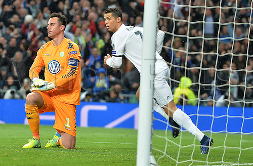 12.04.2016. Madrid, Spain.  Wolfsburg's goalkeeper Diego Benaglio (L) reacts as Cristiano Ronaldo of Madrid celebrates after scoring during the UEFA Champions League quarterfinal second leg  match between Real Madrid and VfL Wolfsburg at the Santiago Bernabeu stadium in Madrid, Spain