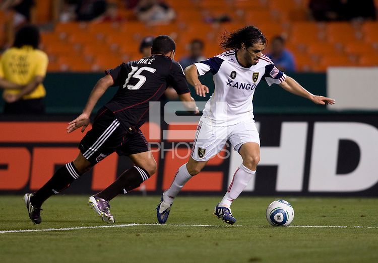 Barry Rice (15) of D.C. United closes in on Fabian Espindola (7) of Real Salt Lake during a U.S. Open Cup tournament game at RFK Stadium in Washington, DC.  D.C. United defeated Real Salt Lake, 2-1, in overtime.