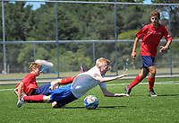 Action from the New Zealand Age Group Championships Under-15 Boys match between WaiBoP (red tops) and Auckland at Memorial Park in Petone, Wellington, New Zealand on Sunday, 17 December 2017. Photo: Dave Lintott / lintottphoto.co.nz