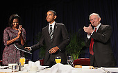 United States President Barack Obama, center, takes his seat while being applauded by First Lady Michelle Obama, left, and U.S. Senator Jeff Sessions, right, (Republican of Alabama) after addressing the National Prayer Breakfast in Washington, DC, February 2, 2012..Credit: Chris Kleponis / Pool via CNP