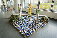 Spanning the Hungry Rapids by Severud Associates  in the 23rd annual Canstruction Design Competition in New York, seen on Friday, November 6, 2015, on display in Brookfield Place. The sculpture is made of 2158 cans and will feed 1672 New Yorkers. Architecture and design firm participate to design and build giant structures made from cans of food.  The cans are donated to City Harvest at the close of the exhibit. Over 100,000 cans of food were collected and will be used to feed the needy at 500 soup kitchens and food pantries. (© Richard B. Levine)