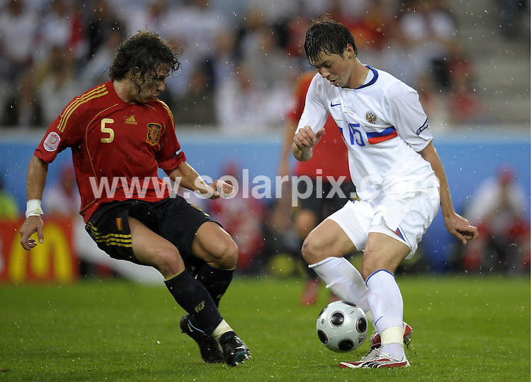 **ALL ROUND PICTURES FROM SOLARPIX.COM**.**SYNDICATION RIGHTS FOR UK AND SPAIN ONLY**.European Championship tournament Euro 2008, Spain versus Russia at the Tivoli-Neu Stadium, Innsbruck, Austria. Spain 4 Russia 1. 10th June 2008..This pic: Carlos Puyol and Diniyar Bilyaletdinov..JOB REF: 6605 CPR/Sascha Schuermann        .DATE: 10_06_2008.**MUST CREDIT SOLARPIX.COM OR DOUBLE FEE WILL BE CHARGED* *UNDER NO CIRCUMSTANCES IS THIS IMAGE TO BE REPRODUCED FOR ANY ONLINE EDITION WITHOUT PRIOR PERMISSION*