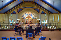 The Brass Quintet at St. Paul Catholic Church makes its debut performance from the choir loft at the church Sunday afternoon. The performance is one in a series of events to help raise awareness and money for the church's plans to install a pipe organ in the loft.