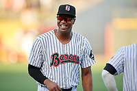 Birmingham Barons left fielder Eloy Jimenez (21) warms up before a game against the Pensacola Blue Wahoos on May 8, 2018 at Regions FIeld in Birmingham, Alabama.  Birmingham defeated Pensacola 5-2.  (Mike Janes/Four Seam Images)