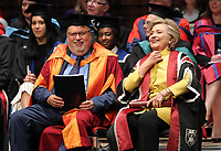 Pictured: Hillary Clinton (R) adjusts her collar at Swansea University Bay Campus. Saturday 14 October 2017<br /> Re: Hillary Clinton, the former US secretary of state and 2016 American presidential candidate will be presented with an honorary doctorate during a ceremony at Swansea University's Bay Campus in Wales, UK, to recognise her commitment to promoting the rights of families and children around the world.<br /> Mrs Clinton's great grandparents were from south Wales.