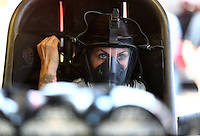 Mar 28, 2014; Las Vegas, NV, USA; NHRA funny car driver Alexis DeJoria warms up her car in the pits during qualifying for the Summitracing.com Nationals at The Strip at Las Vegas Motor Speedway. Mandatory Credit: Mark J. Rebilas-USA TODAY Sports