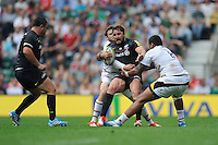 Brad Barritt of Saracens is tackled by Nathan Hughes of Wasps during the Premiership Rugby Round 1 match between Saracens and Wasps at Twickenham Stadium on Saturday 6th September 2014 (Photo by Rob Munro)