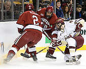 Matt Lombardi (Boston College - Milton, MA) battles with Dylan Reese (Harvard University - Pittsburgh, PA) and Dave Watters (Harvard University - Eden Prairie, MN) for the puck. The Boston College Eagles defeated the Harvard University Crimson 3-1 in the first round of the 2007 Beanpot Tournament on Monday, February 5, 2007, at the TD Banknorth Garden in Boston, Massachusetts.  The first Beanpot Tournament was played in December 1952 with the scheduling moved to the first two Mondays of February in its sixth year.  The tournament is played between Boston College, Boston University, Harvard University and Northeastern University with the first round matchups alternating each year.