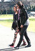 First Lady Michelle Obama walks with daughter Sasha on the South as the First Family returns to White House from their Hawaiian vacation on Sunday, January 6, 2013. .Credit: Dennis Brack / Pool via CNP