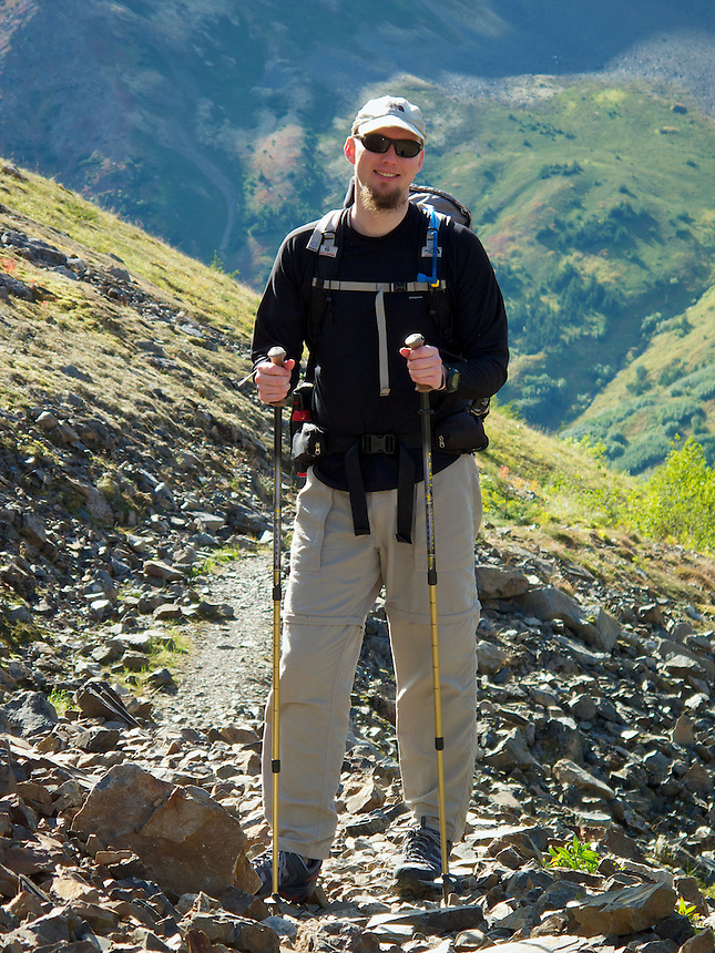 Ron Karpilo hiking the Iditarod Trail in Crow Creek valley near Crow Pass in Chugach National Forest, Alaska, United States.