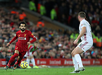 2nd January 2020; Anfield, Liverpool, Merseyside, England; English Premier League Football, Liverpool versus Sheffield United; Mohammed Salah of Liverpool  runs at Jack O'Connell of Sheffield United with the ball  - Strictly Editorial Use Only. No use with unauthorized audio, video, data, fixture lists, club/league logos or 'live' services. Online in-match use limited to 120 images, no video emulation. No use in betting, games or single club/league/player publications