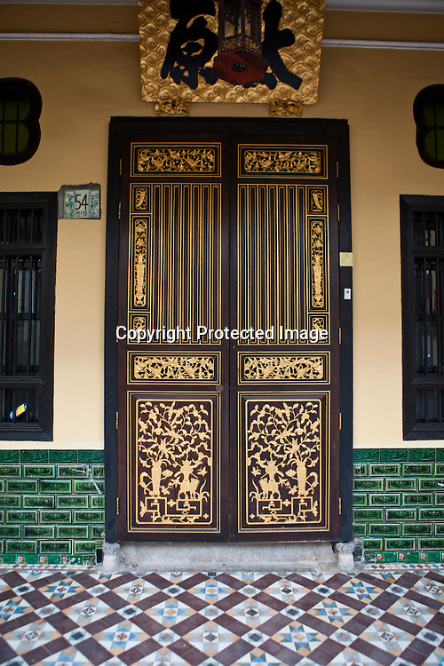 Detail of a door of a restored heritage house in the UNESCO heritage town - Georgetown of Penang, Malaysia. Photo: Sanjit Das/Panos