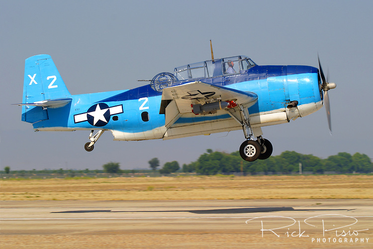 Grumman TBM-3 Avenger, bu85983, piloted by Chuck Wentworth approaches a landing at Minter Field, near Bakersfield, California, during the 2005 Warbirds in Action Airshow. Many of the former torpedo bombers saw duty after the Second World War as sprayers and aerial firefighting platforms.