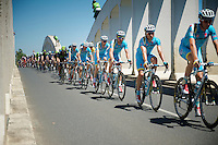 Team Astana leading the peloton over the Sa&ocirc;ne River Bridge with yellow jersey Vincenzo Nibali (ITA/Astana) safely tucked away behind them<br /> <br /> 2014 Tour de France<br /> stage 12: Bourg-en-Bresse - Saint-Eti&egrave;nne (185km)