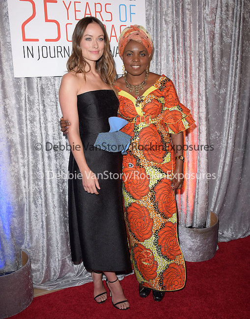 Olivia Wilde and Solange Lusiku Nsimire attends The IWMF Courage in Journalism Awards held at The Beverly Hilton Hotel in Beverly Hills, California on October 28,2014                                                                               © 2014 Hollywood Press Agency