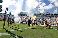 November 08, 2009:    Jacksonville Jaguars mascot Jaxson DeVille runs on the field carrying an American Flag during Military Appreciation Day prior to the start of action  between the AFC West  Kansas City Chiefs and AFC South Jacksonville Jaguars at Jacksonville Municipal Stadium in Jacksonville, Florida............
