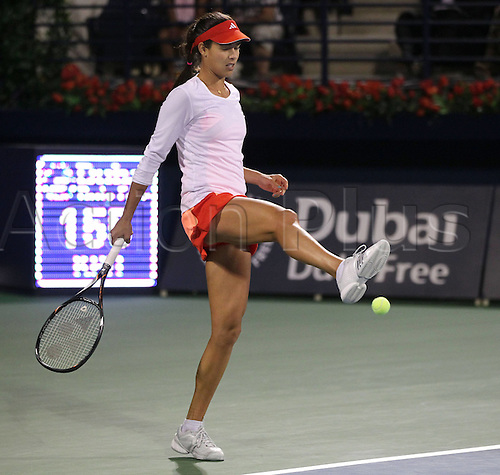 23 02 2012  Dubai Tennis Championships 2012 WTA Tennis Tournament International Series Dubai Tennis stadium, UAE. Ana Ivanovic Srb kicking the Ball with her foot